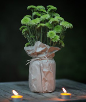 Vase covered with craft paper bag - Photo from bvweddings.com