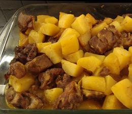 xoirino sto fourno me patates kai portokali