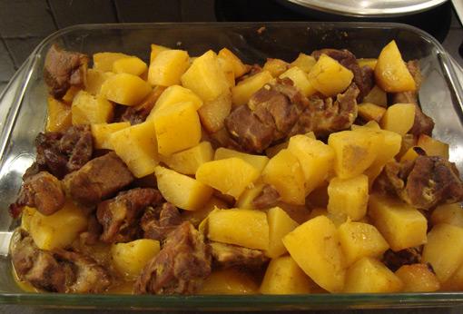 xoirino me patates kai portokali sto fourno