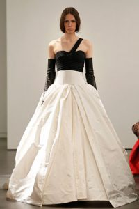 Light ivory and black one shoulder silk faille gown with hand wrapped detail at bodice and hand draped accents on skirt