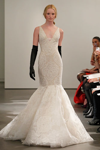 Ivory and nude V-neck sleeveless lace mermaid gown with hand appliquéd Chantilly lace accents and guipure lace back