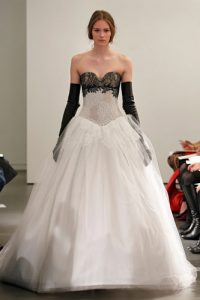 Light ivory and black strapless multi lace gown with hand pieced Chantilly lace appliqué details