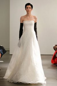 Ivory strapless mermaid guipure lace gown with silk organza overlay accented with hand pieced Chantilly lace