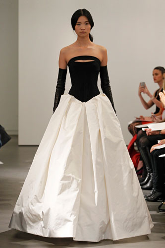 13.	Light ivory and black strapless gown with silk ottoman bodice, hand draped silk faille skirt and contour band accent at neckline