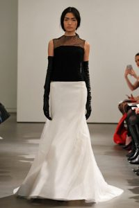 Light ivory and black sheer back strapless mermaid gown with silk ottoman trapunto stitched bodice and silk satin faced organza skirt with tulle overlay. Black bubble lace open back, crew neck t-shirt