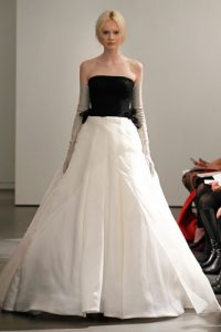 Light ivory and black strapless gown with diamond quilted bodice, hand draped satin faced silk organza skirt and hand cut silk organza petal accents