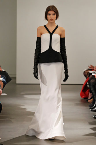 Light ivory and black Y-neck architectural silk faille soft mermaid gown with peplum accent at waist