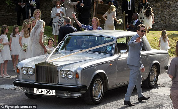Kate Moss & Jamie Hince leaving with a Rolls Royce after their wedding